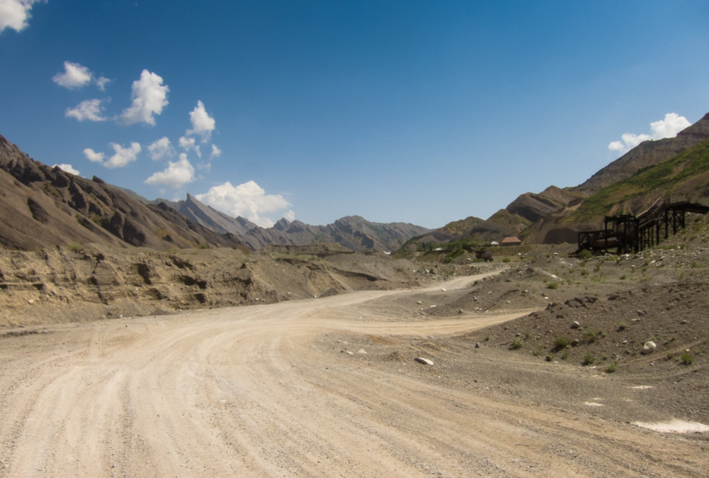 Intense Tajikistan heat and sunshine along the route thorough abandoned, and a few active, mining towns.