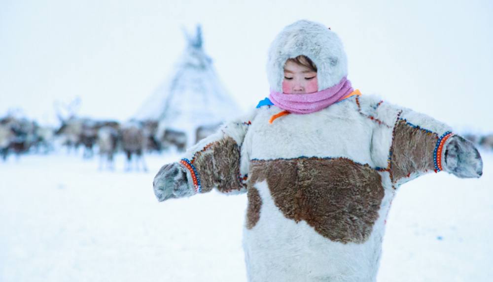 The elements are no match for traditional Nenets' winter costume. Dressed properly, Christina can play outside for hours.