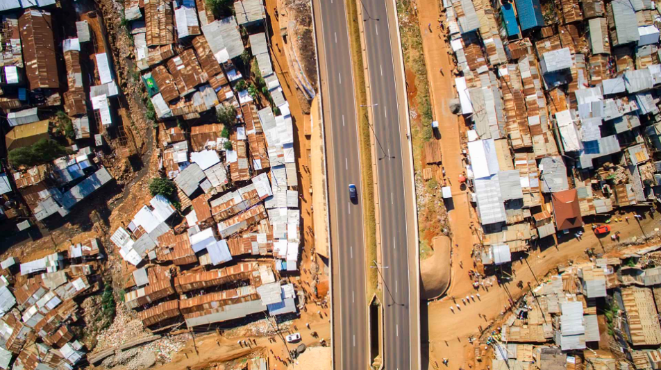 The Southern Bypass road has already lopped a portion off of Kibera, in the quixotic search for a less congested city. Although there is an underpass (visible at the bottom), people often cross the road from above, resulting in many accidents.