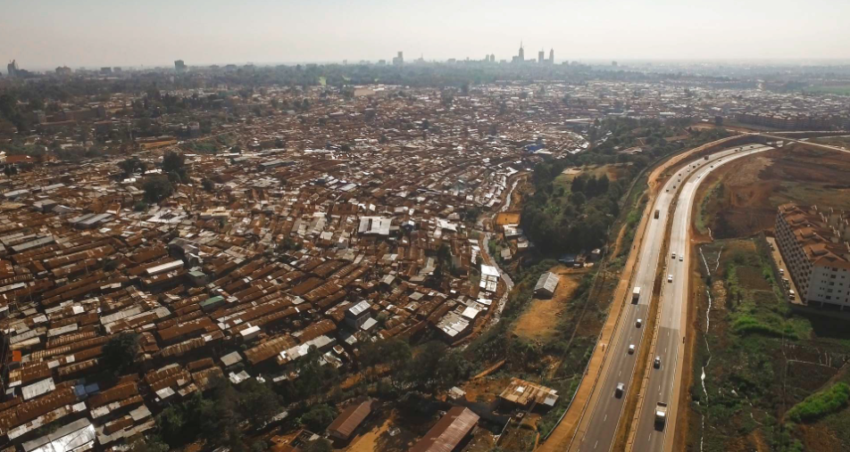 The Southern Bypass road follows the contours of the river and slum next to it. In the distance, you can see the construction beginning on the new road, which will connect Ngong Rd to Langata Rd.