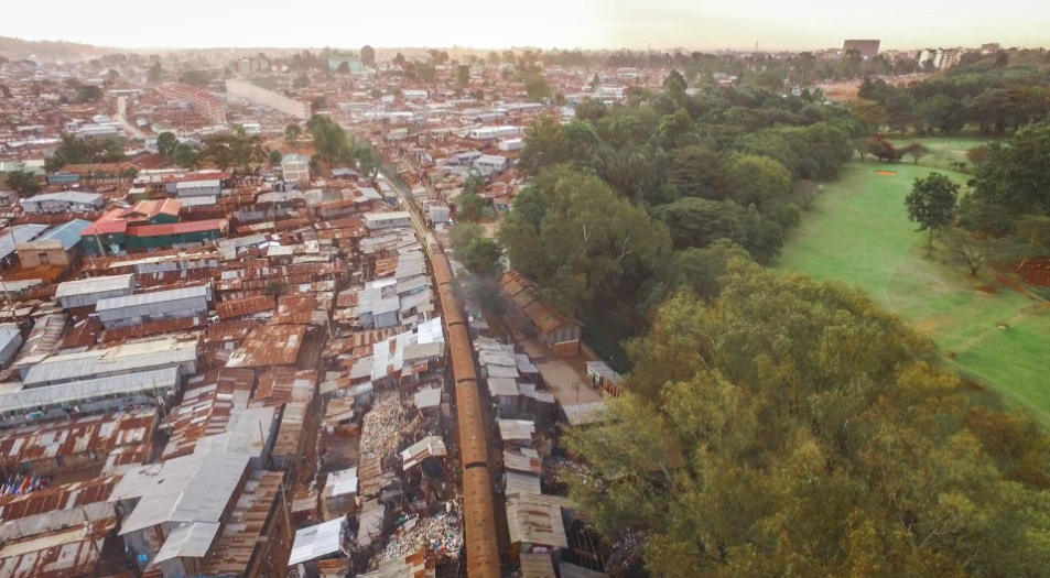 The train is a part of life to Kibera, a source of transportation, of annoyance, of time passing.