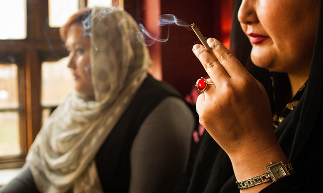 Women smoke inside Laila Haidary's restaurant on March 13 2017 in Kabul, Afghanistan. Smoking is considered a taboo for women, especially in public.
