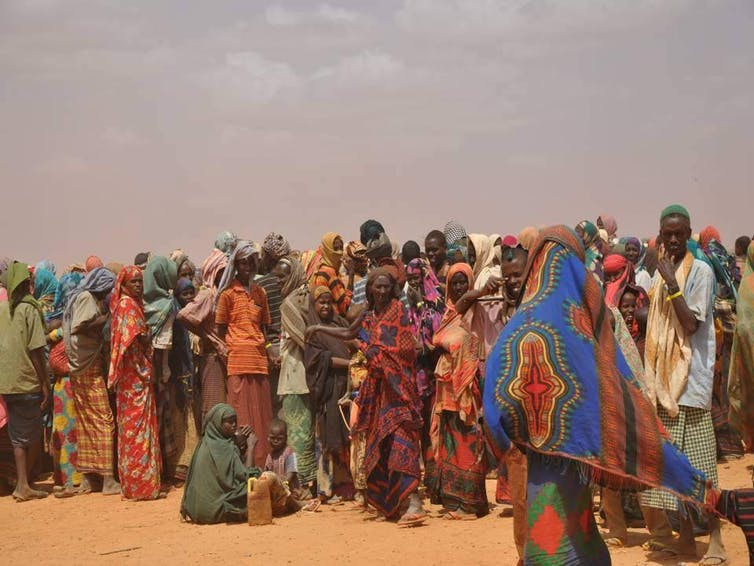 People displaced by drought in Somalia queue to register at a refugee camp in neighboring Ethiopia, July 26, 2011. UK-DFID, CC BY