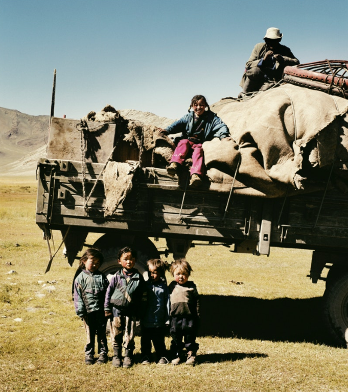 "A herder, his wife, and their five young children make their way to winter pastures, transporting their ""ger"" or yurt and all their belongings."