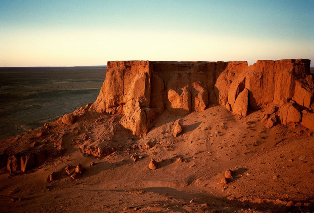 "Bayanzag (Улаан Эрэг) or the ""Flaming Cliffs"" in Mongolia's Gobi Desert are said to appear to be on fire as the sun sets."
