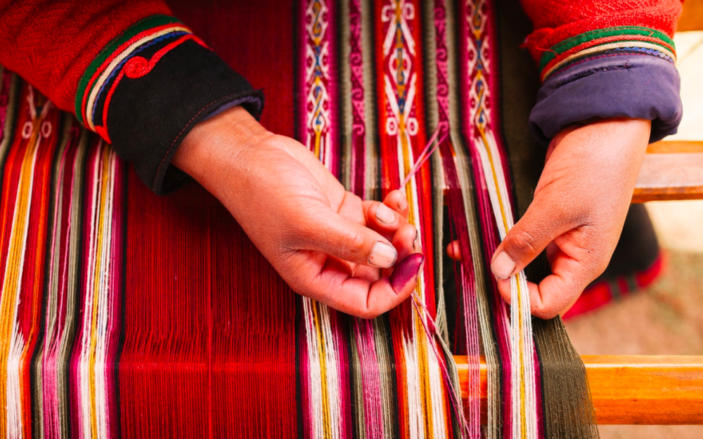 Above: Detail of Asunta, a young Andean weaver from a traditional Quechua community in the Piuray Lagoon weaving a new textile. Weaving is done using a simple backstrap loom, and the pattern design is woven only from memory.