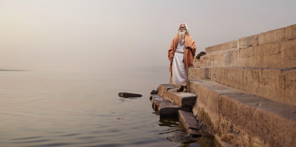 Above: Baba Vijay Nund on the steps of Chet Singh Ghat on the banks of the Ganges River.