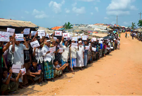 Rohingya refugees holding placards, await the arrival of a U.N. Security Council team in Bangladesh, on April 29, 2018.AP Photo/A.M. Ahad