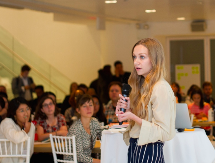 Photo of Kelley Louise speaking at 2017 Impact Travel Global Summit. Photo by Naomi Figueroa.