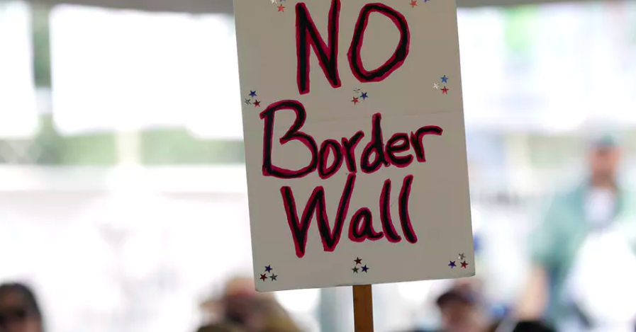 A 'no border wall' sign is held during a rally to oppose the wall the US government wants to build. AP Photo/Eric Gay