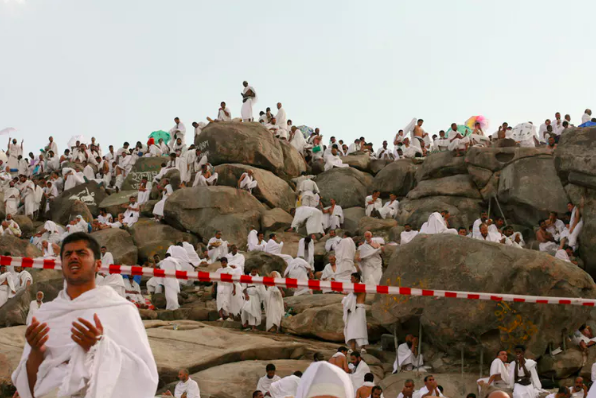 Pilgrims praying on Arafat.  Al Jazeera English ,  CC BY-SA