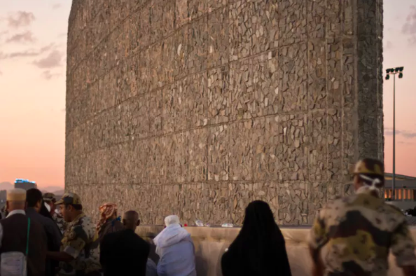 Pilgrims stoning the devil in Mina.  Al Jazeera English ,  CC BY-SA