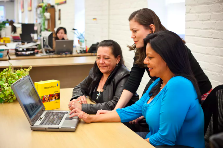 Members of the Chitimacha language team (from left to right) Sam Boutte, Kim Walden and Rachel Vilcan use the new language software for the first time. Author provided