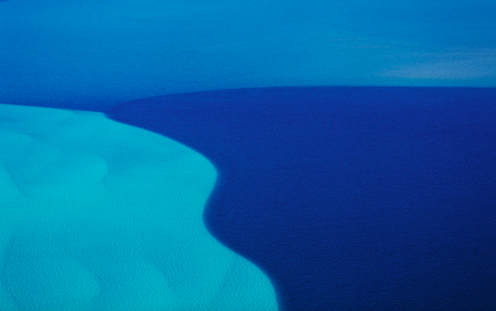 Ocean between Ningaloo Reef and Coral Bay, Western Australia. The blue variation is due to the ocean's floor level. (Taken 2006)