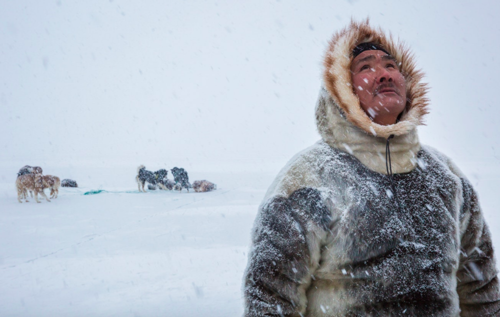 As he lifts his eyes to the falling snowflakes, Naimanngitsoq Kristiansen, a traditional Inuit hunter from Greenland, reminds me that nature is a spiritual sanctuary, made all the more hallowed by the first flurry of snow in Spring.    Greenland