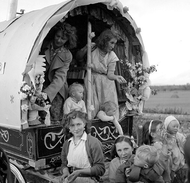 Irish Travellers in a decorated caravan, 1954. Unknown (via The National Library of Ireland on the Commons).  Wikimedia Commons .