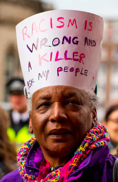 A woman protests racism at a London rally. John Gomez/Shutterstock.com