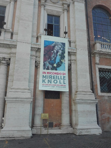A banner in Rome commemorates the life of Mireille Knoll, a Holocaust survivor who was murdered in her apartment in Paris last year. Jove. CC0.