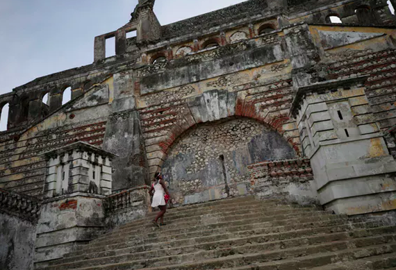 A woman climbs the stairs on the remains of Sans-Souci Palace in 2017.  Andres Martinez Casares/Reuters