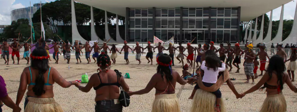 Munduruku tribal people are demanding that Brazil's government respect their land rights.  AP Photo/Eraldo Peres