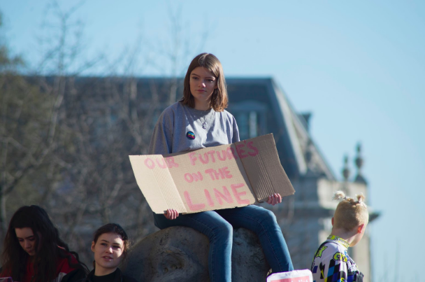 Photo of a student protester. By  Josh Barwick  on  Unsplash .