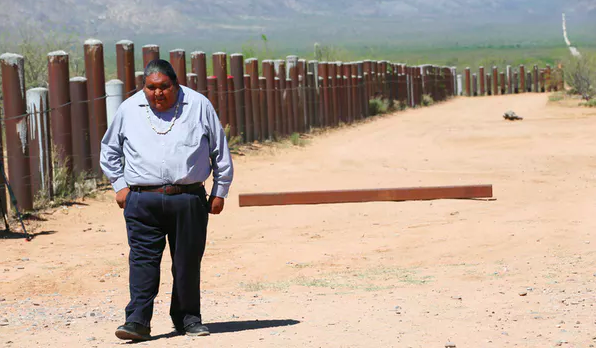 Verlon Jose, vice-chairman of the Tohono O'odham Nation, at the border barrier that traverses the Tohono O'odham reservation in Chukut Kuk, Ariz., in 2017. Reuters/Rick Wilking