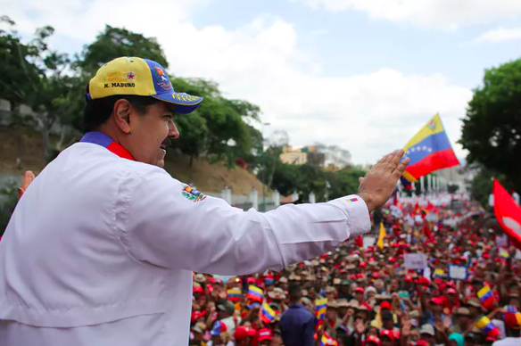 Eighty percent of Venezuelans oppose Maduro, but he retains some popular support – and the power of the Venezuelan armed forces. Miraflores Palace via Reuters