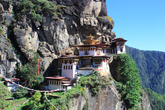 Paro Taktsang, a Himalayan Buddhist sacred site and temple complex, located in the upper Paro valley. Arian Zwegers. CC BY 2.0