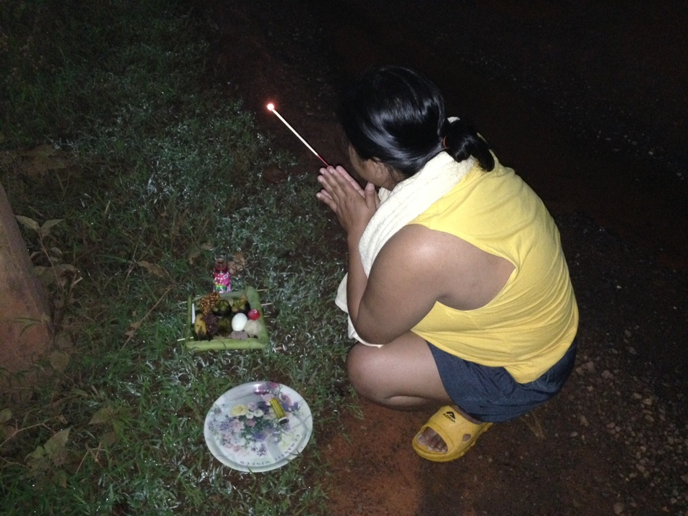 """A Thai tradition of """"feeding"""" the ghosts/spirits. Once a year, they leave an offering of food near their home, typically on the side of road."""