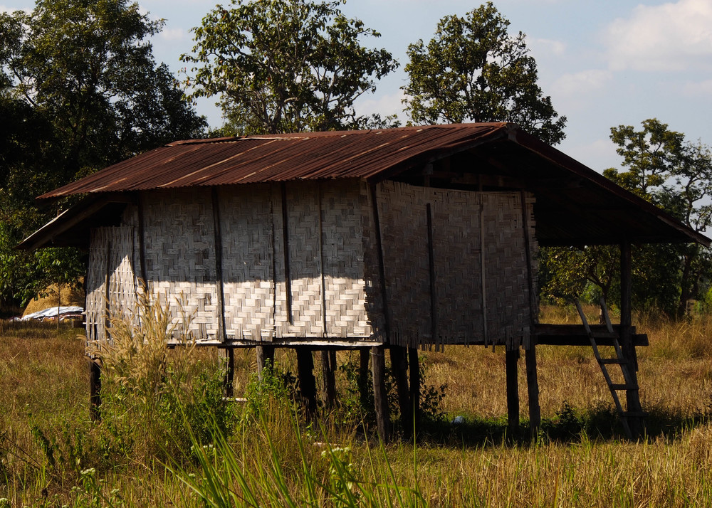 These types of houses are very common around the countryside in rural, northeast, Thailand. No Water. No Electricity. No Screens.