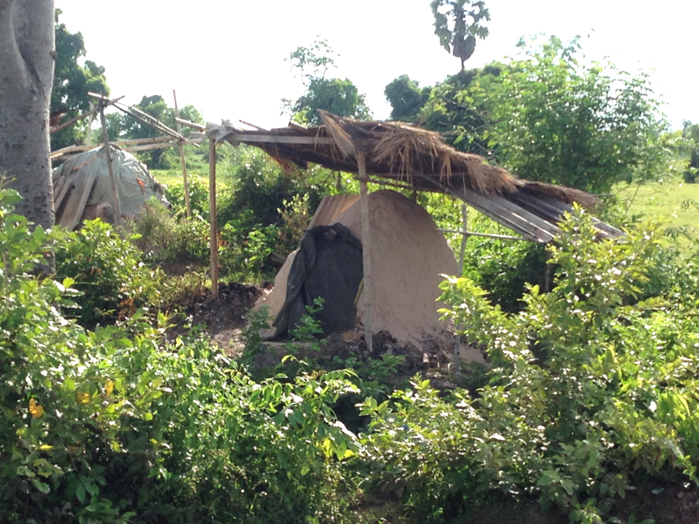 Charcoal huts - a common sight - where charcoal is made by burning wood.