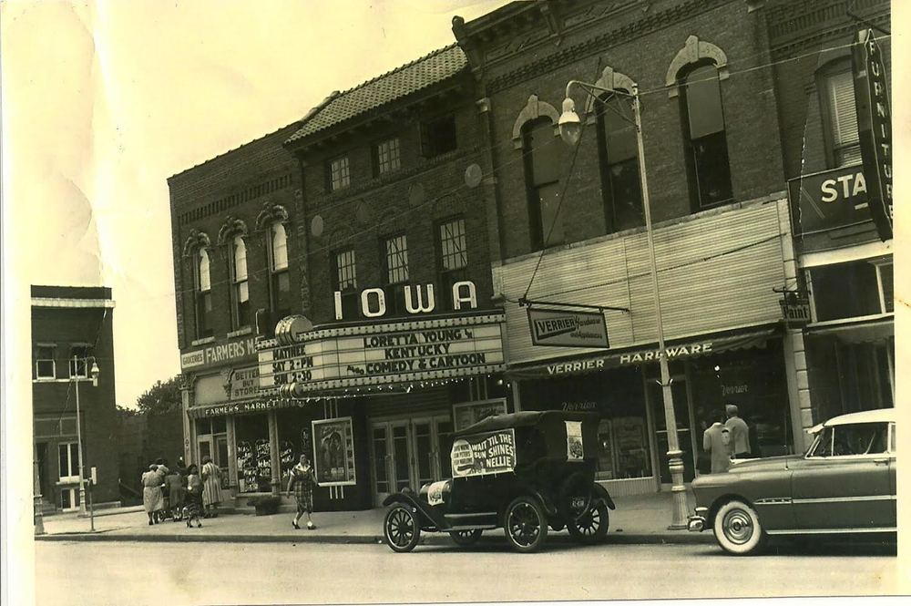 "Photo of The Iowa Theater, circa 1940s (the Ford Model T car visible is a promotional vehicle). The film advertised on the marquee is ""Kentucky"", released in 1938 and starring Loretta Young. Photo provided by Gary Allen."