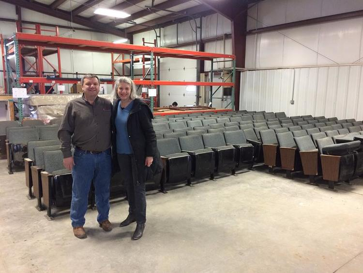 Pat Riley of Rainbow International of Winterset and Marianne Fons stand in front of The Iowa's chairs. Pat and the team at Rainbow are generously storing and cleaning The Iowa's chairs!