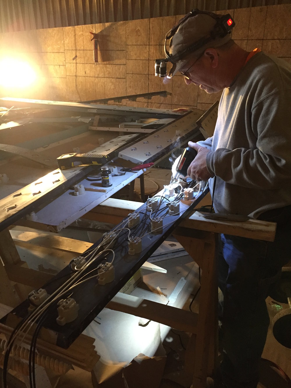 Our amazing electrician Bob Swanson solders the Iowa's marquee sockets, May 2017.