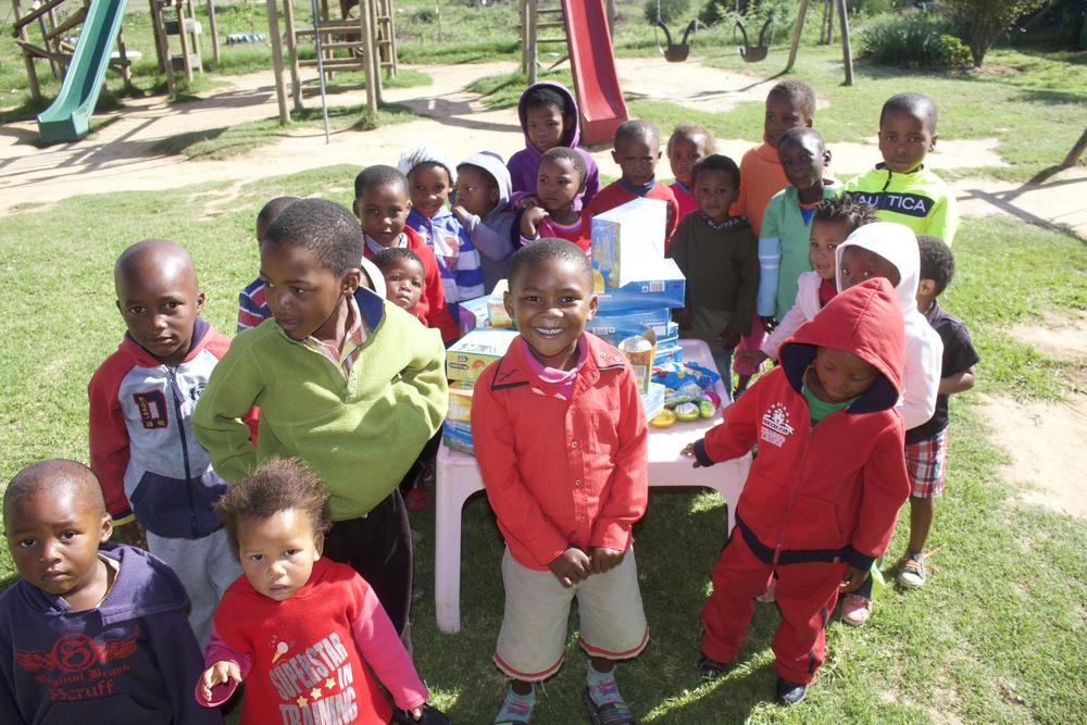 The Langbos Creche & Care Centre currently serves as a pre-school for up to 50 children, as well as a soup kitchen, HIV support group, and community center for the greater Langbos community.  We are working together with the Langbos community and the Langbos Creche & Care Centre to help improve the lives of the children and families of Langbos.  For more information, visit  http://www.intsikelelo.org/langbos-creche-care-centre/