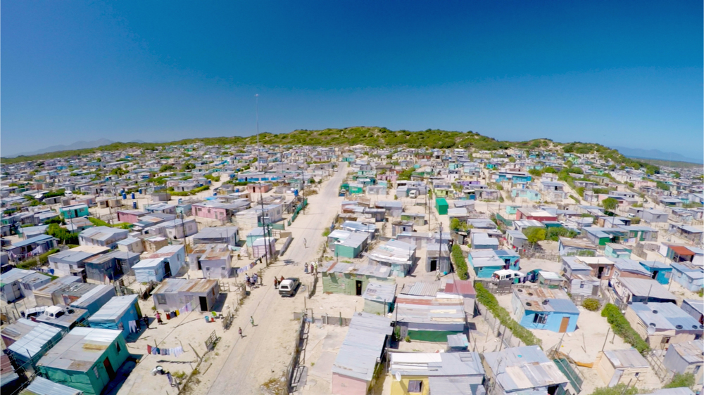 Aerial shot of Khayelitsha.  Khayelitsha is home to an estimated 1-2 million people. T he unemployment rate is roughly 40%, with 55% of the population living in informal shack housing