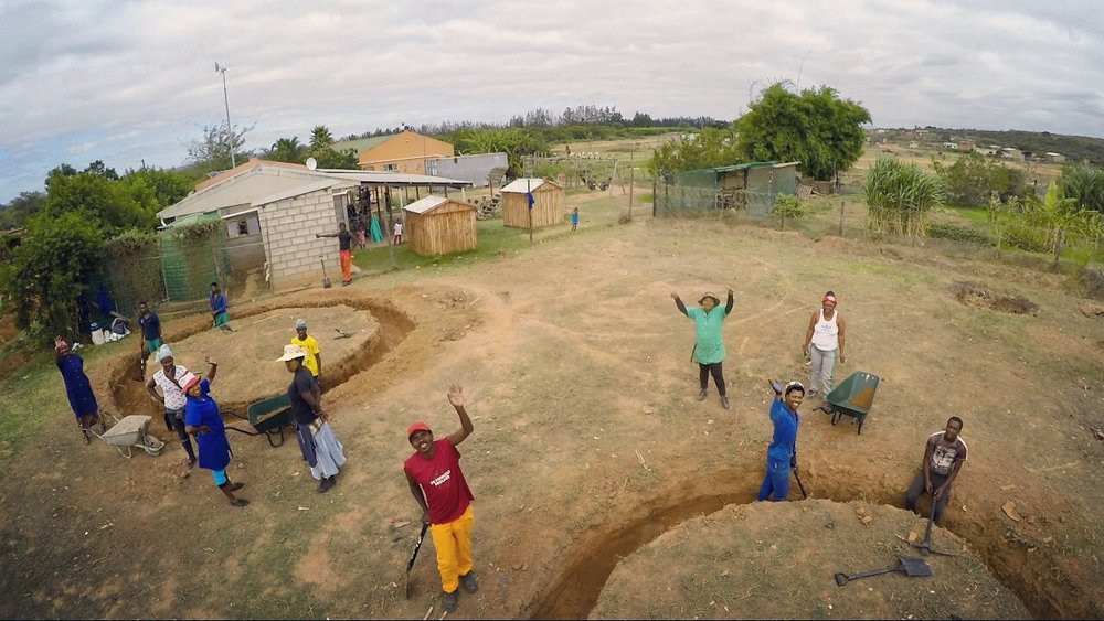Men and women from the Langbos community breaking ground on the Langbos Children's Home, February 2017