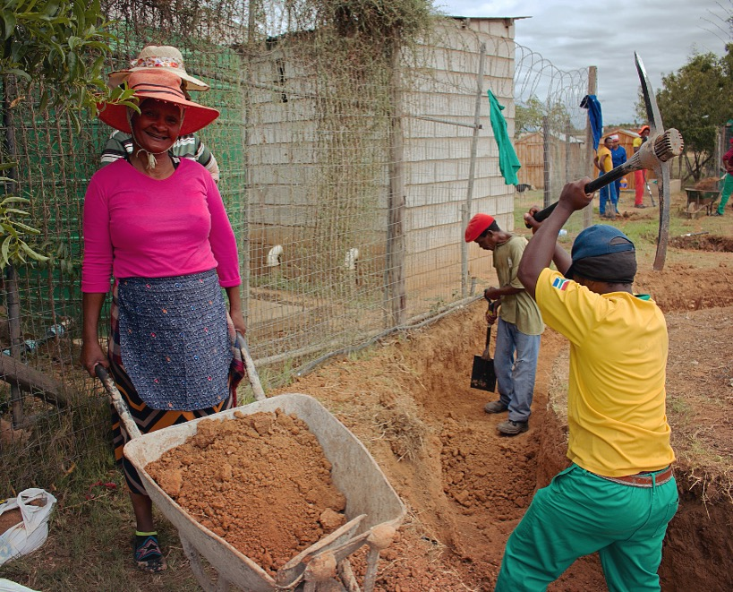 Men and women of all ages have come together to help build the Langbos Children's Home.