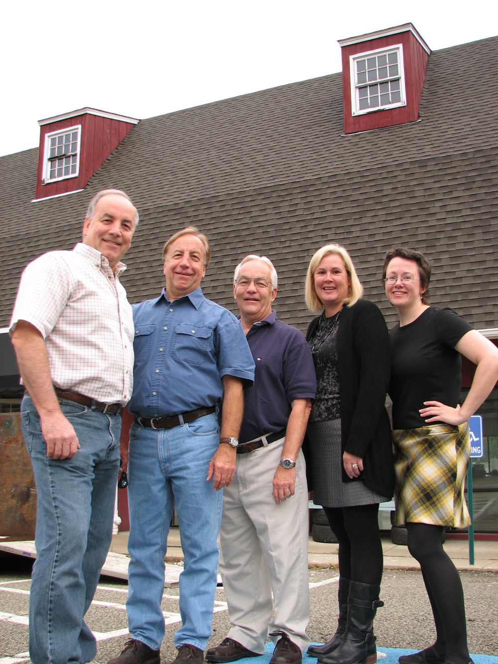 From left to right:  Doug, Chuck and Bob Satterfield, Kate McGrady, and Kate Wagle Hitmar in front of the barn at the start of construction in October 2014.