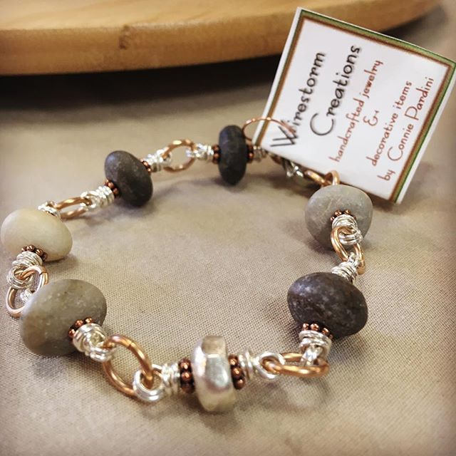 Drilled pebbles, sterling silver and bronze bracelet (and also necklaces, rings, and earrings) by Connie Pardini | @wirestorm_creations.  Meet Connie today, 12/9 until 6pm, at our Artist Meet & Greet.  #handmadefortheholidays #jewelry #handmadejewelry #shoppgh #shoplocal #shopsmall #shophandmade #pgh #pghart #pittsburgh #theartsmiths #artsmithspgh #trunkshow