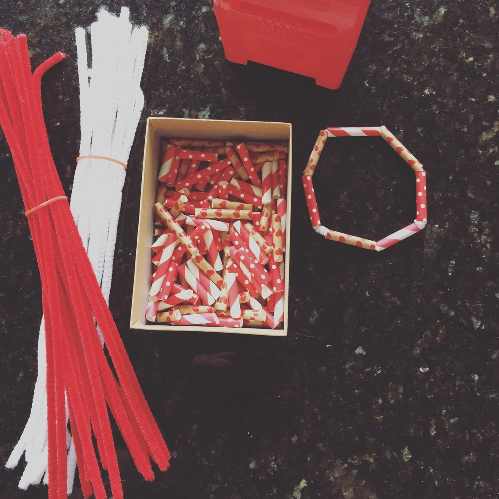 Cut up decorative straws to make beads.