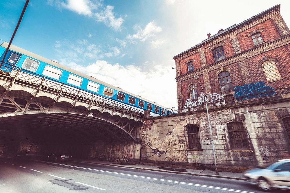 old-abandoned-building-with-steel-railway-bridge_free_stock_photos_picjumbo_DSC04142-1570x1047.jpg