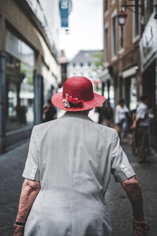 fabio-neo-amato-708467-unsplash back of old woman walking.jpg