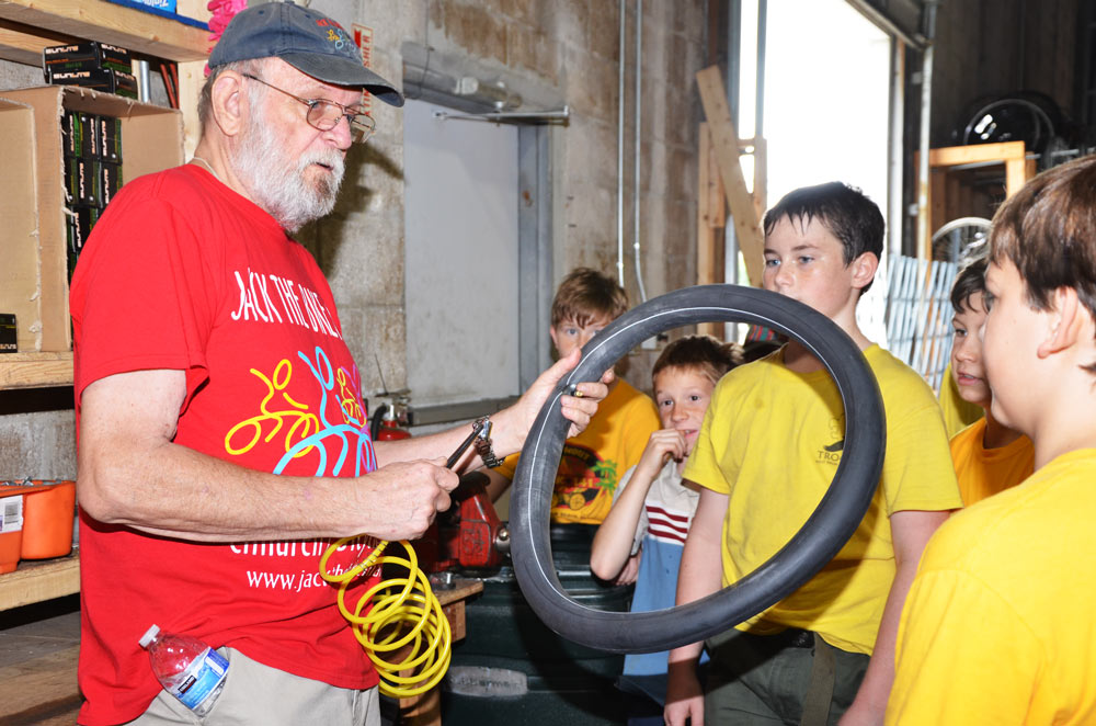 Jack teaching kids how to inflate tires!