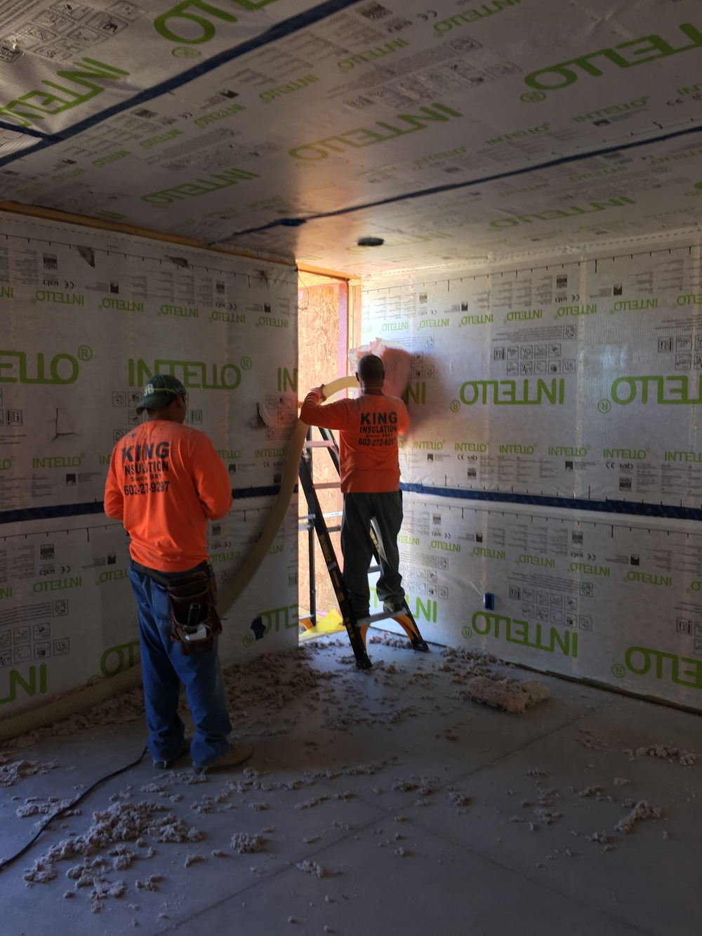 "Applying blow-in cellulose insulation. 100% recycled content and more effective than conventional insulation. Much less prickly to work with too. And all the ""waste"" you see on the floor can be swept up and put back into the blower, so there is ZERO waste!"
