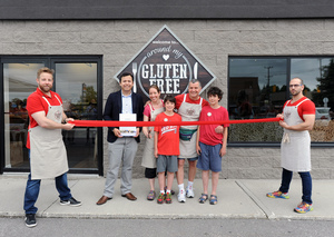 Ward 9 Councillor Sergio Morales joins owner Laurie Rosanelli and her family at the grand opening & ribbon-cutting of her business Around My Gluten-Free Table, located at 411 Huronia Rd