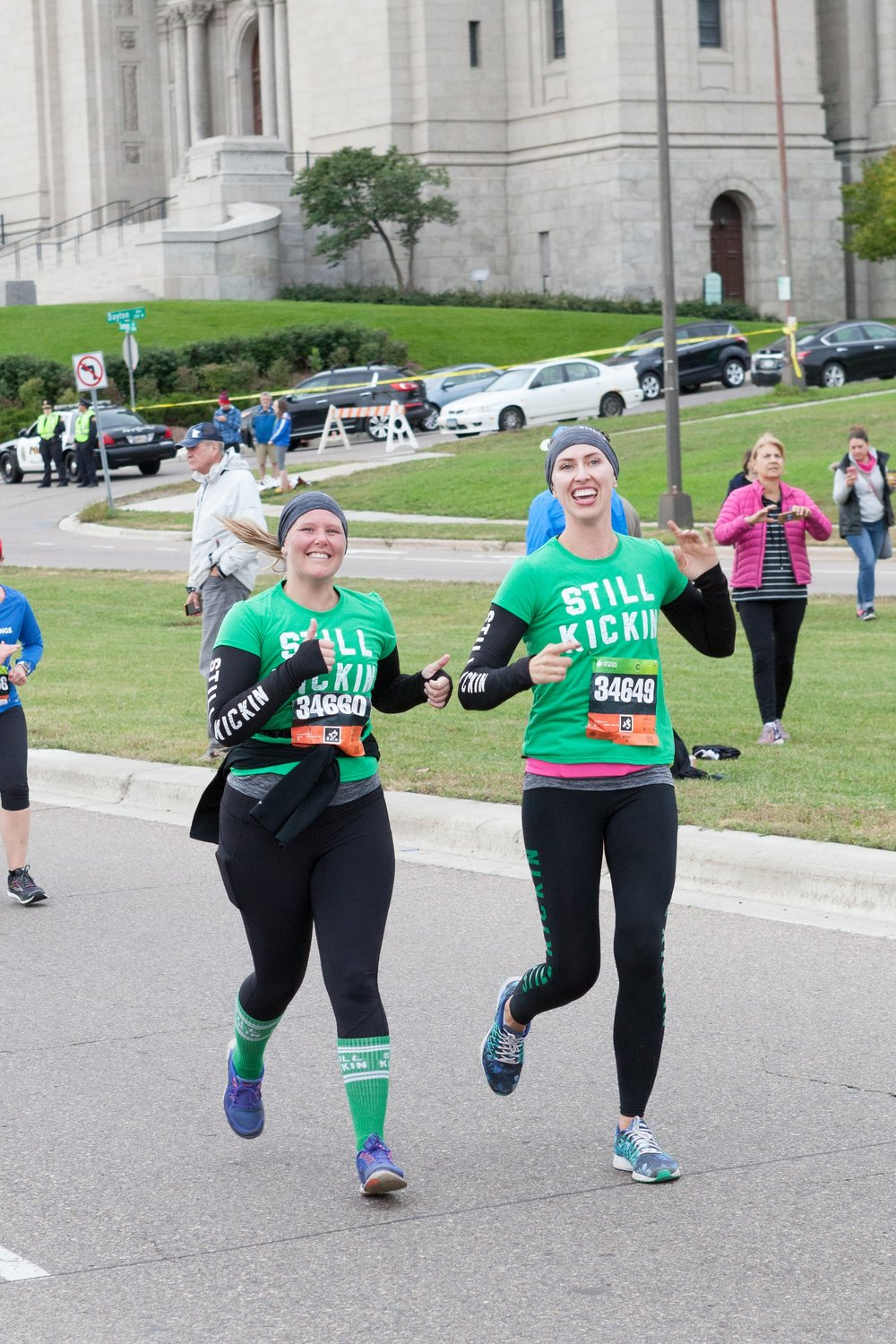 Lindsay and Nora running the TC 10-Mile / Photo by Melissa Floyd Photography