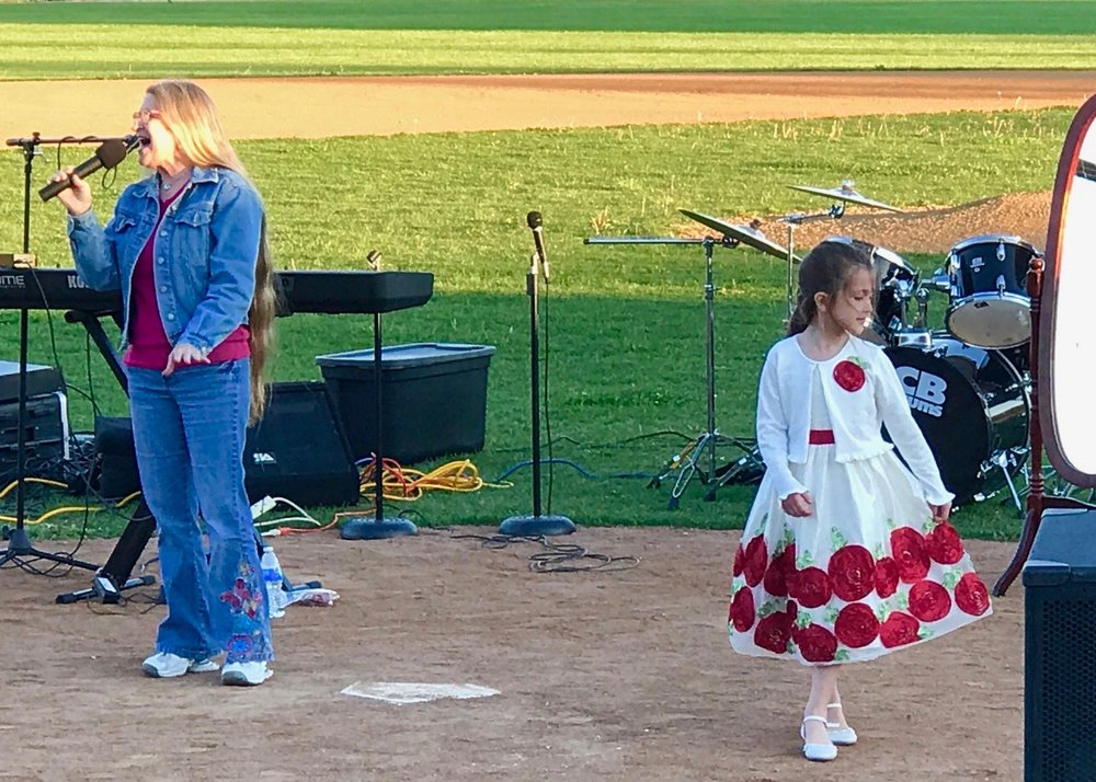 """Poppy sang the song """"Priceless"""" by For King and Country. My daughter Rayna had a white dress on and danced along. This was such a beautiful time declaring God's love over the crowd!"""