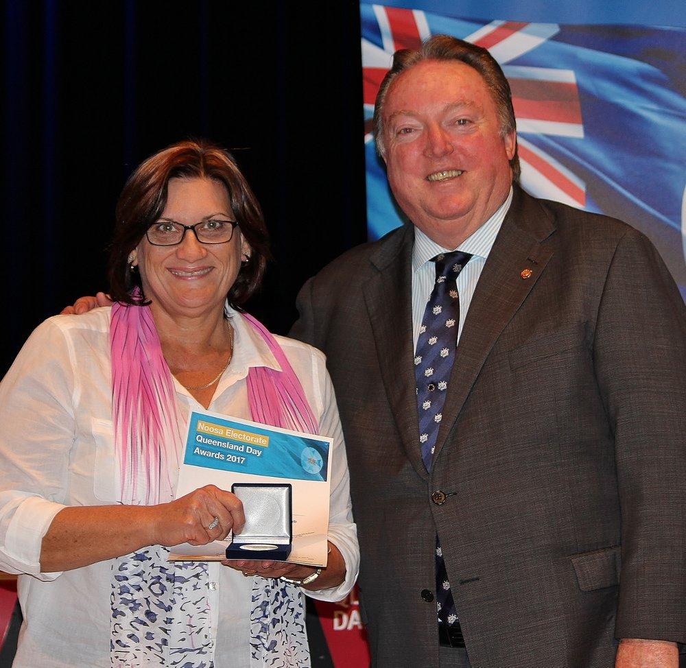 Marie Cairrns celebrates her award with Glen Elmes - Copy.jpg