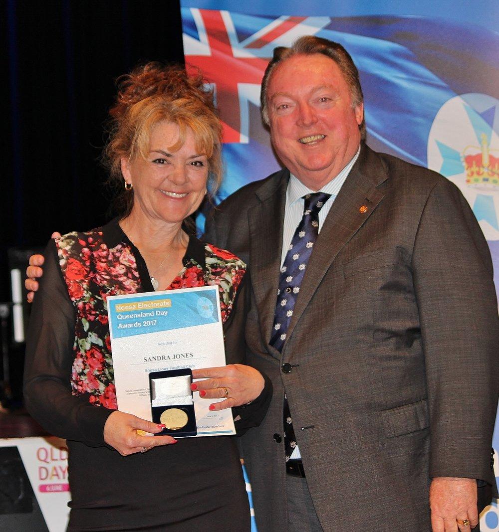 Sandra Jones celebrates her award with Glen Elmes - Copy.jpg